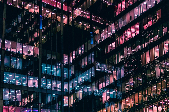 Closely huddled glass offices at night
